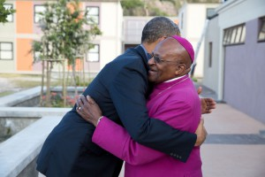 President Obama greets Archbishop Desmond Tutu in 2013.